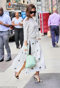 6d2ebd88b Victoria Beckham oozes elegance in a flirty floral skirt and jumper