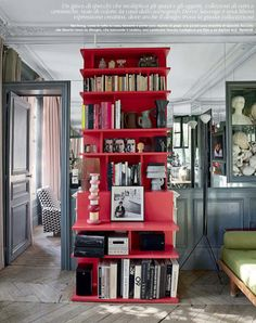 a chic red bookcase is everything. via elle decor march Red Bookcase, Bookshelves, Annie Leonhardt, Grey Woodwork, Interior Inspiration, Design Inspiration, White Subway Tiles, Elle Decor, Spas