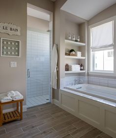 For Upstairs bathroom, like the niche above the bathtub with shelves, the tile around the splash area and the wood front. Wall color is Sherwin Williams Amazing Gray SW7044