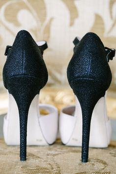 The black heels on these white pumps add some Art Deco drama-- we're in love! {Riverland Studios}