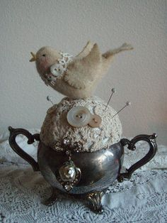 Ok, so I'm not going to do the bird but I'm definitely making the pin cushion--awesome  Vintage pincushion by lauriescharmingdesigns, via Flickr