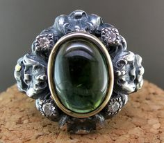 Hand Forged Silver, 18 Karat Yellow Gold, and Green Tourmaline Ring, accented with Diamonds