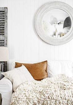 Leather pillow on white sofa. The Giant Oversized Chunky Knit Throw Blanket Grey Interior Design, Home Interior, Coastal Interior, Living Spaces, Living Room, Cottage Living, Cozy Cottage, Coastal Living, Leather Pillow