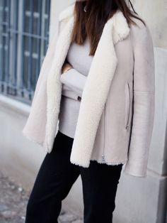 Funda Christophersen rocks this white sheepskin shearling jacket. The simplicity of this look affords instant chic; we love it. Jacket: Hunkydory, Sweater: Graumann, Jeans: Seafarer.