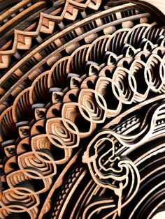 Oakland-based artist Gabriel Schama creates laser-cut wood relief wall art that feature layers of intricate swirls and abstract patterns. Myriads of geometric lines take the shape of human silhouettes, architectural elements, and mandala-like designs. Wooden Wall Tiles, Wood Wall Art, Woodworking Jigs, Woodworking Projects, Woodworking Classes, Laser Cut Wood, Laser Cutting, Wood Sculpture, Sculptures