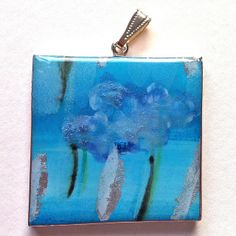 Pendant -from my vast range of papier-mâché jewellery. These resemble enamel. Painted images under resin.