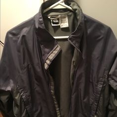 North face rain coat womens Never worn but tags are off; great for spring and fall! Purple and grey; zipper works great! North Face Jackets & Coats