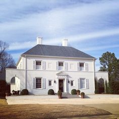 Simplicity is beauty in this white-on-white, symmetrical home in Birmingham, AL by James Carter (via Limestone Boxwoods' instagram).