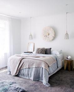 Beautiful bedroom with a White Bamileke Feather Headdress   Juju hat