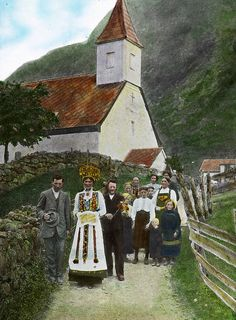 Norwegian wedding procession, 1915. Look at the outfits. I love the orange-red /Scandi-rust color of steeple and the roof. Very festive...