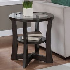 The modern Eclipse end table features a rich espresso finish, making it an ideal choice for any contemporary decor. This end table also offers a clear glass top and a lower shelf design that completes the look of this elegant piece. Living Room Furniture, Modern Furniture, Home Furniture, Furniture Design, Asian Furniture, Garden Furniture, Glass Top End Tables, Glass Table, Regal Design