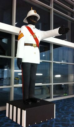 Sculpture of Bahamian Police Officer by Keisha Oliver  directing arriving visitors to the Bahamas