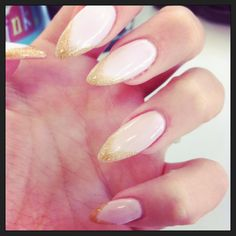 almond acrylic nails, nude colour with gold glitter