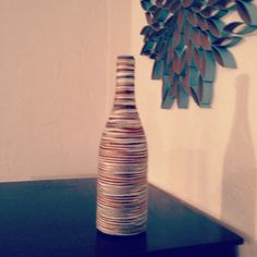 Yarn wrapped wine bottle vase- with toilet paper roll art.....