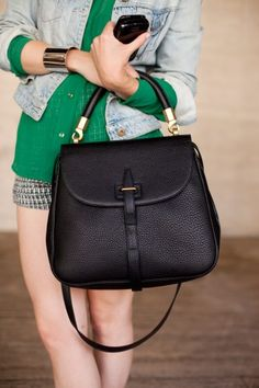 Geri Hirsch was spotted carrying this black beauty by YSL. #handbags