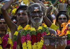 Hindu people at firewalking ceremony - Tamil Nadu - India by Eric Lafforgue, via Flickr