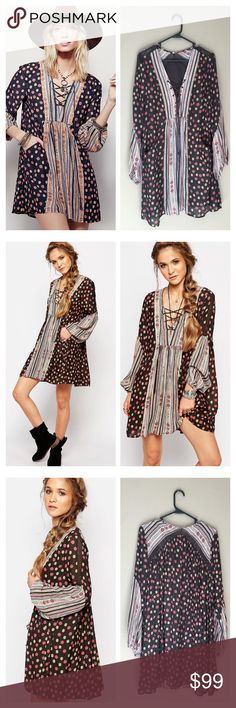 Free people rain or shine dress In a boho, swingy silhouette,, this effortless printed mini dress is perfect for anything! Lace-up detailing on the neckline, crochet trim, and elastic band on the cuffs. Front pockets. Lined.  100% Polyester. Size Large. Runs true to size Free People Dresses