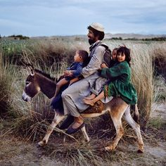Photo taken by @stevemccurryofficial // This father in Maimana, Afghanistan, was taking his children home on the family donkey.  There is evidence that this ancient town was inhabited as early as the 12th century BCE.