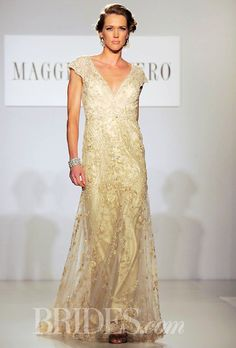 """Brides.com: . """"Tuscany"""" gold lace and beaded tulle sheath wedding dress with a…"""