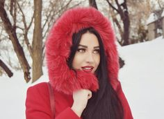 Red riding hood style. Winter. Snow. Red lips. Fur