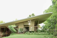 This architectural design features a majestic green roof that follows your landscape! | Yanko Design Web Design, House Design, Yanko Design, Sand House, Space Projects, A Frame Cabin, Open Wall, Glass Facades, Box Houses