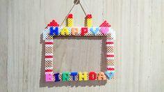アイロンビーズで作ったフォトフレームです。誕生日用にケーキ風にしました。プレゼントにもどうぞ。