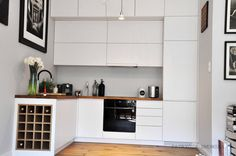 light grey modern kitchen, countertop wood oak  interior design by Dmowska Design Patrycja dmowska / projekt restauracji Dmowska Design Patrycja Dmowska