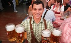 Nomadic Matt celebrating Oktoberfest in Germany with many beers Sauerkraut Balls Recipe, Craft Beer Fest, Munich Oktoberfest, Beer Decorations, Travel Europe Cheap, British Beer, Homemade Soft Pretzels, Beer Festival, Throw A Party