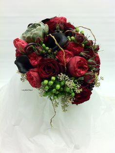 Bride's bouquet.  Succulent, callas, fiddle heads, garden roses, hypericum, Bush Ivy berries, seeded eucalyptus, curly willow