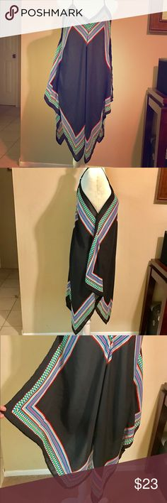 🌺Meraki Dress🌺 🌺Flows fitting dress. 🌺Black with multicolored stripe. 🌺Never worn. Size: L 🌺 100% Polyester 🌺 Adjustable Strap 🌺 Pit to Pit: approximately 19'' 🌺 Length: Approximately 36'' Meraki Dresses
