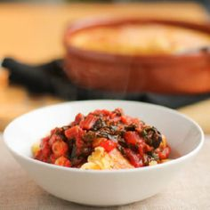 Polenta Al Forno with Swiss Chard-Tomato Sauce – Indulgent two-cheese baked polenta lightened up a little with a vegetable sauce