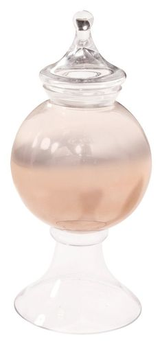 Features:  -Material: Glass.  -Finish: Rose gold ombre.  -Clear stem and lid.  Primary Material: -Glass.  Color: -Rose gold ombre.  Style: -Traditional/Glam.  Product Type: -Jar.  Shape: -Novelty. Dim