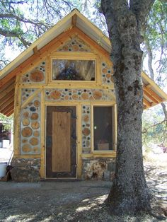 Small timber frame with cordwood infill | designed and built by Nick Kautazer