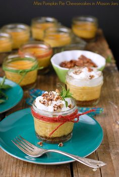 Mini Pumpkin Pie Cheesecakes in Mason Jars. Light and creamy, a perfect dessert after a Thanksgiving feast!
