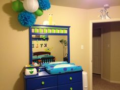 Changing station for Monsters inc nursery. I simply purchased a dresser from garage sale and repainted it to reflect our theme. I love the way it turned out.