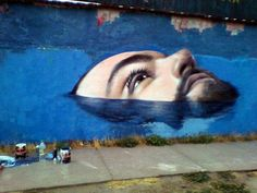 Herz~working on a new mural in Chile