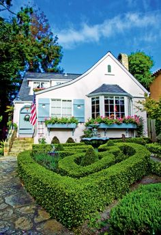 Cottage in Carmel, CA  Love blue shutters, bay window with small panes,flower boxes,stone path and cute garden!!