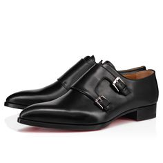 The Dear Tok shoe is distinguished by its sleek and slender silhouette, and pays tribute to the London music scene of the 1970s. Its black leather upper is set on a small heel with a solid sole and discreet stitching, and its two side buckles play with asymmetry. This city shoe is emblematic of Maison Christian Louboutin elegance. Men's Shoes, Dress Shoes, Red Sole, Formal Shoes, Online Boutiques, 1970s, Calves, Stitching, Christian Louboutin