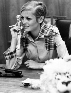 """Teenage British fashion model Twiggy holds the 11"""" fashion doll created in her image by US firm Mattel in 1967."""