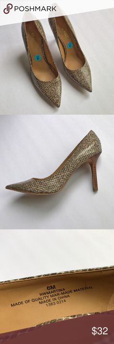 {nine west} Martina brown snake skin style pumps Gorgeous textured heels are cream and brown colored. Pointed toe shoes are stylish and NWOT. tried on but never worn outside. Stylish neutral heels for professional work settings and versatile enough for a night out. Nine West Shoes Heels