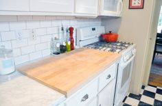 16Reader Space:  An Organized Kitchen with Class!  I love the idea of a removable counter covering butcher block!