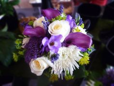 Purple and white bride's bouquet with callas, roses, freesia and lavendar.