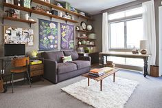 love the shelves above the sofa.  this is good inspiration for the combo office/rec room we're going to end up with someday.