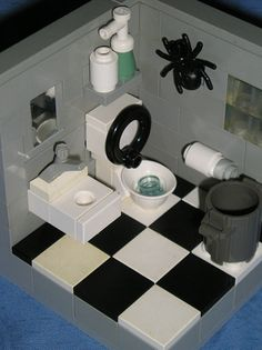 a great little bathroom by Daniel Patrick...the spider is a humorous touch! Dang spiders do love to hang out in the bathroom.