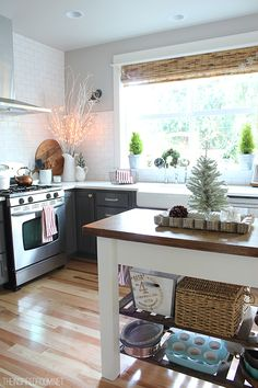 The Inspired Room Kitchen - Christmas House Tour. Love the black cabinets in a white kitchen.