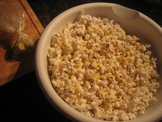 New Dutch cheese popcorn    2 T. sunflower or walnut oil  1/2 c. popcorn  2-3 T. good quality butter  1/4-1/3 c. nutritional yeast  salt & pepper to taste    Pop the popcorn in the oil in a heavy pot on the stove (full instructions).  Toss with butter, yeast, salt & pepper while still very hot. You'll be a convert, too.    Nutritional yeast is available in the refrigerated bulk section of most natural food stores.