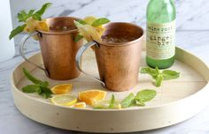 This Orange Mule recipe is a tangy twist on the Moscow mule and a refreshing cocktail for summer. Serve in a copper Moscow mule mug to keep it cold.