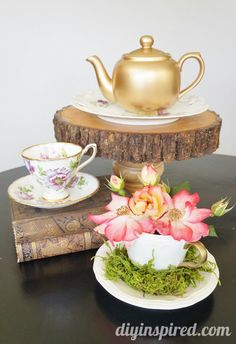 I love this idea from DIY Inspired - how to paint thrift store teapots to use as vases or centerpieces