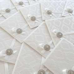 Luxury white flocked wedding invitation with brooch