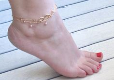 """Infinity Gold Anklet with pearls - Multistrand Ankle Bracelet - Gold Anklet - Infinity Anklet - Delicate Ankle Bracelet  This Infinity Gold Anklet with pearl is so pretty and delicate. 2 strands of gold plated chain , adorned with gold plated Infinity and tiny peals.  The length of this anklet is approx. 8.5 """" (21 cm), with an extender chain to 10.5 """" (27 cm).  Available also in silver.  $14"""